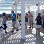 Tanzunterricht auf der Sonnenlounge mit Blick über die Anlage